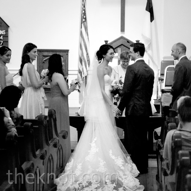 Kelly wore a strapless lace-trimmed wedding gown and finished it with a simple veil.