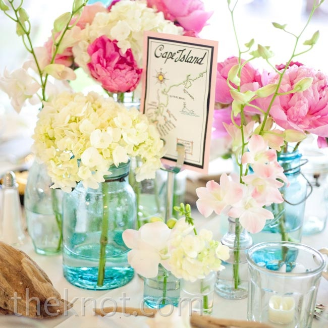 Small arrangements of pink peonies, sweet peas, and orchids topped the tables to create a fresh, just-picked look.
