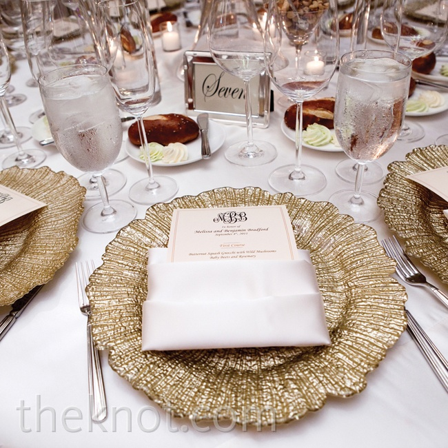 The dinner tables took on a sophisticated vibe with ivory linens and glitzy gold leaf chargers.