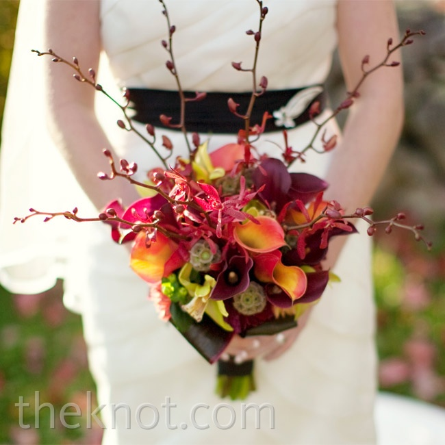 Laura carried burgundy calla lilies, scabiosa pods, and James Storie orchids.