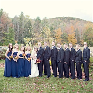 The bridesmaids wore navy dresses, while the guys matched in blue ties.