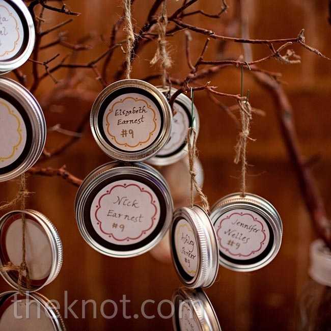 Hanging Mason jar lids were a fun way for guests to find their seats.