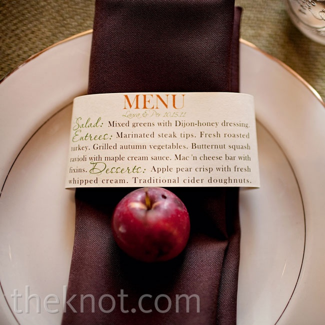 To complement the rustic-elegant theme, gold-rimmed china was topped with deep-brown napkins, menus and crab apples.