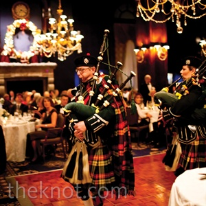 The Union League Club's fireplaces, warm colors and Christmas decor set the perfect stage for the holiday-themed look. For the big entrance, bagpipers led the couple and the bridal party into the reception.