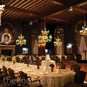 The Union League Clubs fireplaces, warm colors and Christmas decor set the perfect stage for the holiday-themed look. For the big entrance, bagpipers led the couple and the bridal party into the reception.