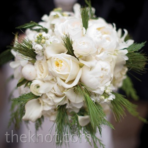 Even though peonies weren't in-season, the florist found some to add to Katie's white bouquet, which also included roses, calla lilies and evergreen sprigs.