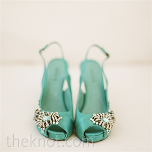 Jessica and Christopher both brought the color teal into their attire. He wore a screen-printed tie, and she donned a crystal-encrusted pair of peep-toe heels.