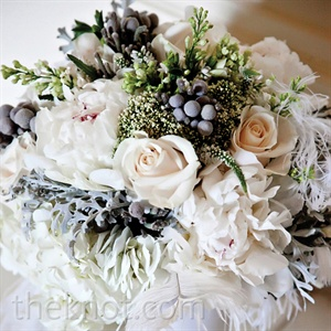 Ashley carried a textural bouquet of ivory garden roses, grevillea, lisianthus, peonies and chocolate cosmos (for the sweet scent), all wrapped with ostrich feathers at the base.