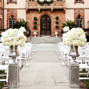 Clusters of white hydrangeas framed with ostrich feathers added a whimsical element to the ceremony.