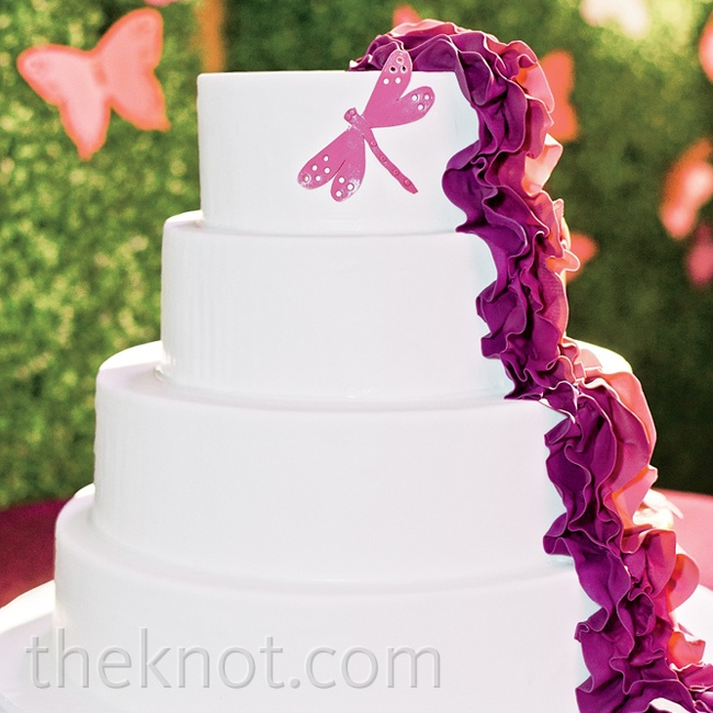 The cascading fabric of Betty's dress inspired the ruffled sugar ribbon on the fondant cake, and a dragonfly decal tied in with the rest of the wedding's garden details.