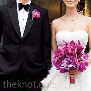 A single fuchsia bloom popped on Edwards crisp tux. (The couple chose orchids as their wedding flower because they love how delicate and complex they are, and incidentally, part of Bettys Chinese name means orchid.)