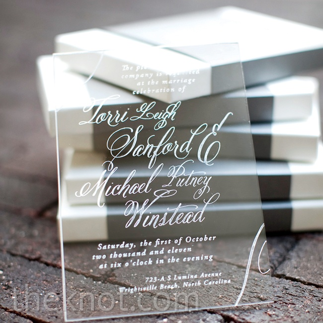 Looking to wow the guests right away, the couple had their invitations etched on pieces of clear acrylic.