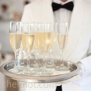 Formal, suited servers passed around flutes of champagne to go along with light bites. The rest of the evening's food was displayed in stations around the tent.