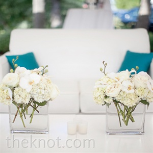 For the lounge area, clear square vases held low arrangements of orchids and hydrangeas, which coordinated with the taller and more dramatic centerpieces that adorned the dinner tables.