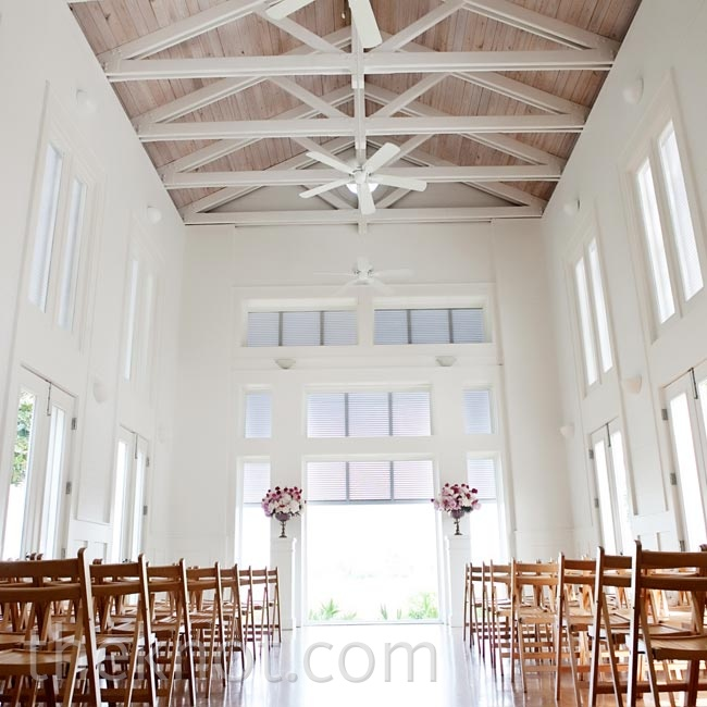 The couple loved the way the bright, sun-doused chapel looked on its own so much that they kept their decor very minimal--just two floral arrangements to mark the altar.