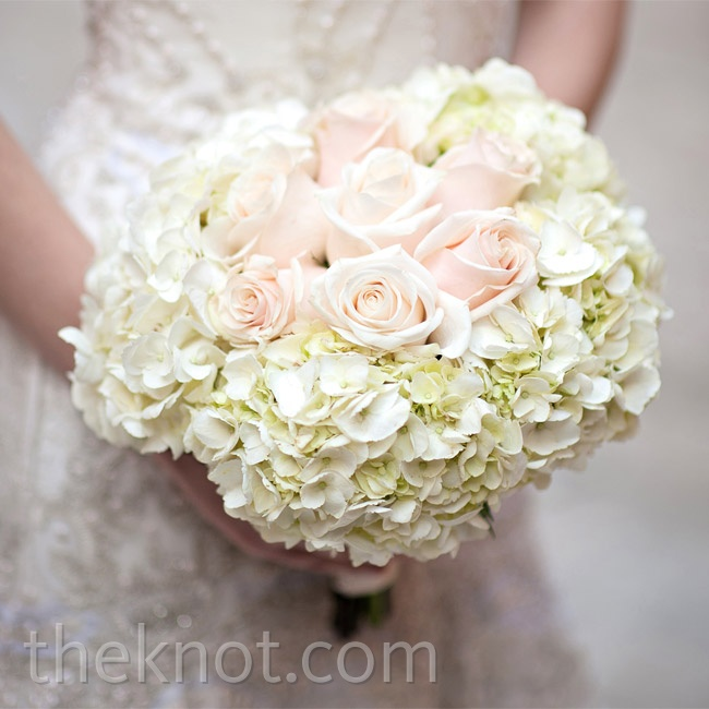 Blush roses surrounded by lush white hydrangeas made for a voluminous, romantic bouquet.
