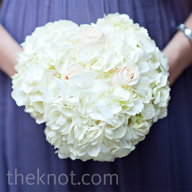 Deniza's bridesmaids held small posies made of white hydrangeas.