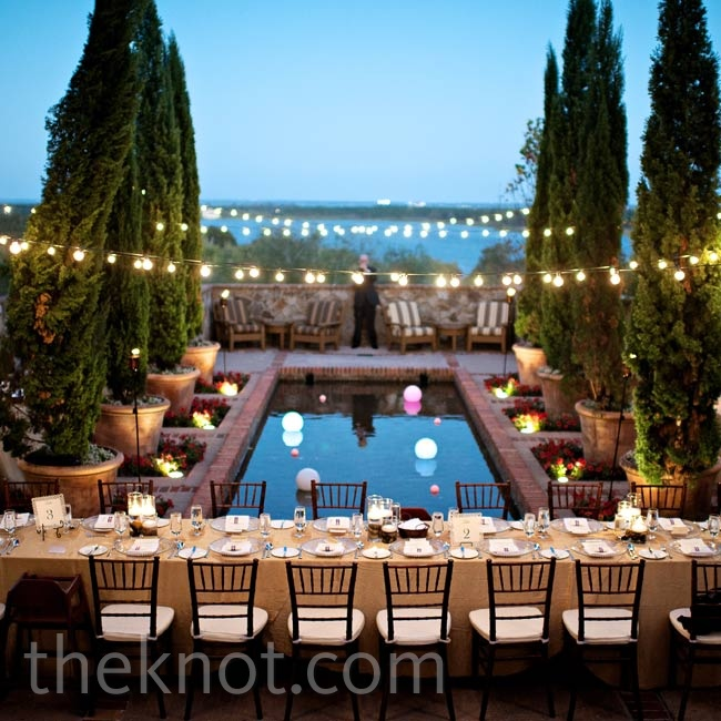 Hanging cafe lights and glowing tiki torches created a warm ambience for the outdoor party.