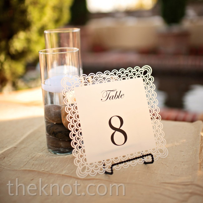Deniza printed the table number cards herself and used an intricate hold punch to create the patterned edges.