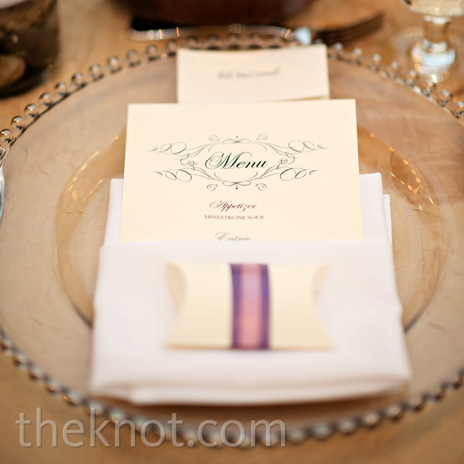 To conform with the classic look of the rest of the reception, glass chargers were paired with white napkins and ivory menus.