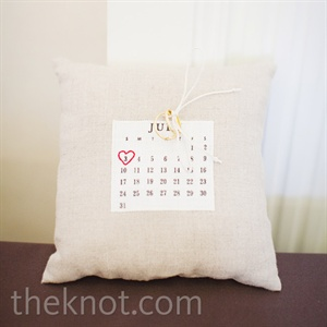 The couple's wedding date was circled with a heart on their calendar ring pillow.