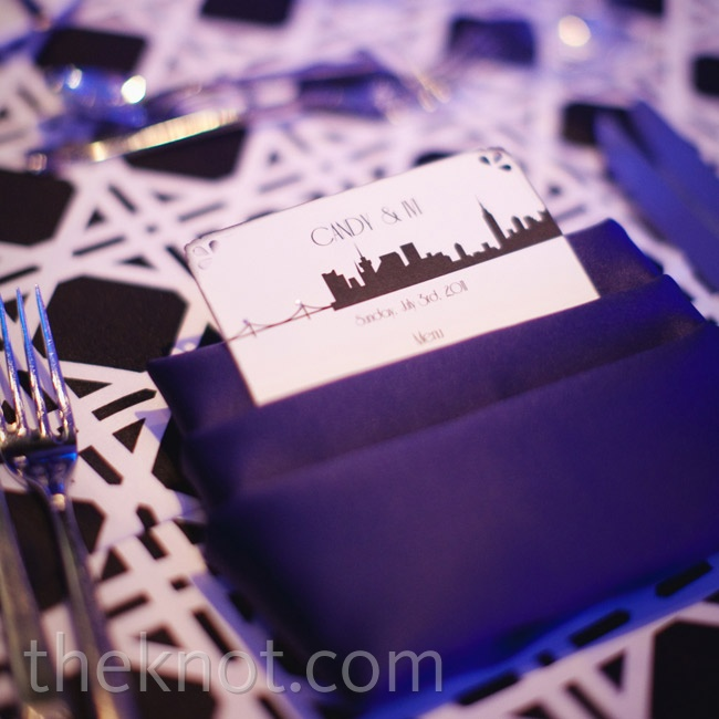 Geometric patterned tablecloths were bold and graphic, while menu cards decorated with the New York City skyline incorporated the theme.