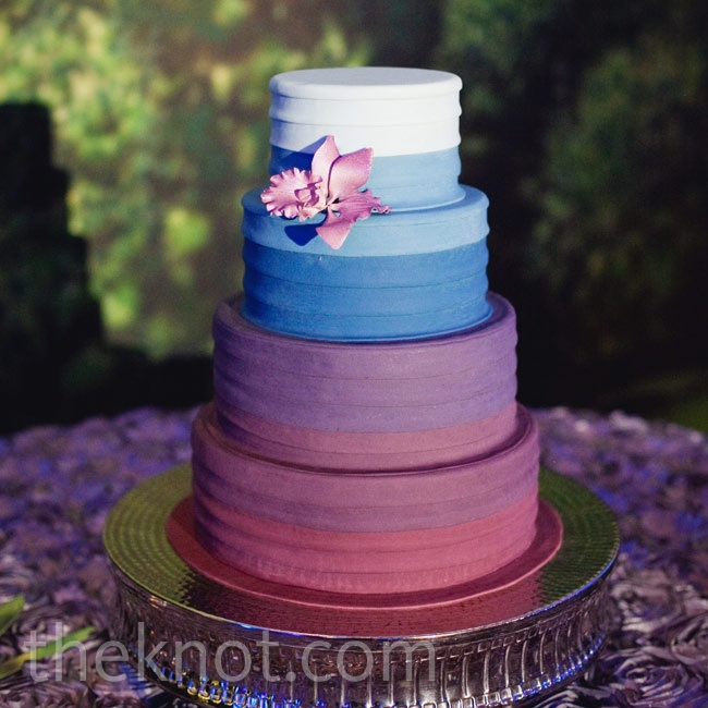 The couple wanted their cake to have unusual colors, and this purple-to-blue confection certainly fit the bill. A sugar orchid tied it into the wedding flowers.