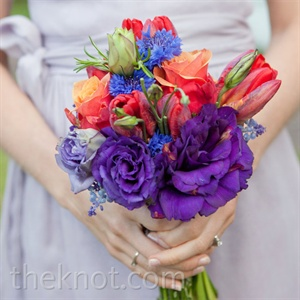 The girls carried bouquets that resembled colorful, gathered wildflowers.
