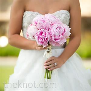 The only flower in Lara's bouquet--pink peonies--had just the right delicate texture to compliment her soft and floaty gown.