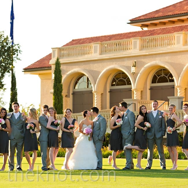 The groomsmen's gray suits coordinated with the darker bridesmaid dresses without matching exactly.