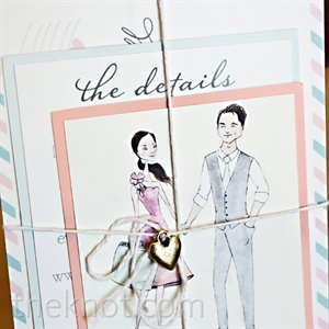 Three cards tied together (a sketch of the couple, a list of travel info, and a card printed with the wedding date) compromised the save-the-dates.
