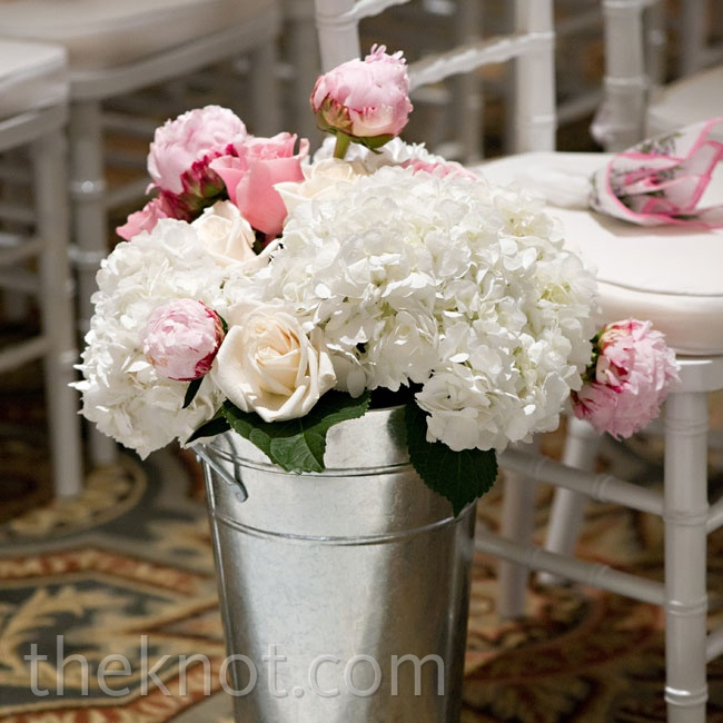 Tall galvanized buckets filled with pink and white flowers lined the ballroom aisle.