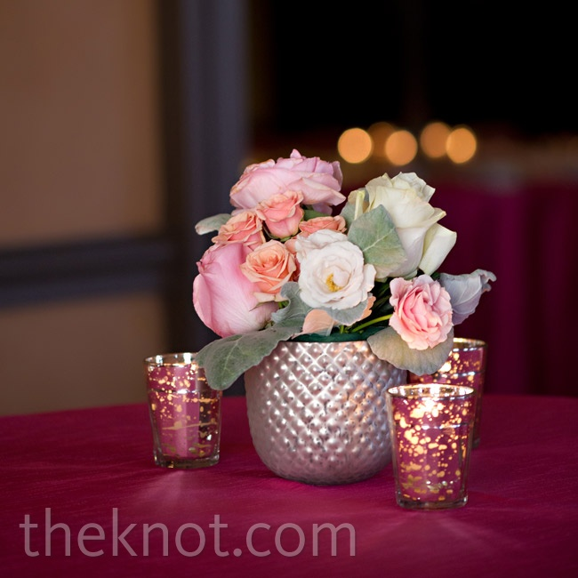 Dusty miller and roses in shades of pink and peach loosely arranged in vintage-looking vessels added plenty of romance to the tables.