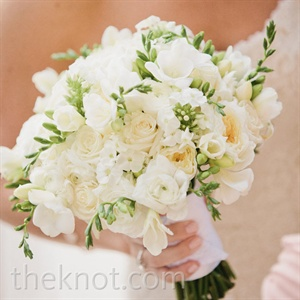 In keeping with the style of her traditional wedding dress, Lindsay's bouquet was a timeless mix of white spray roses, peonies, freesias, and ranunculus.