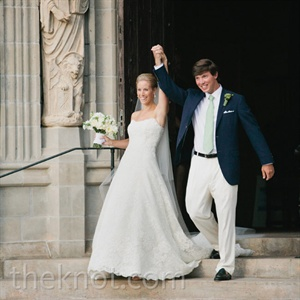 Although many of their wedding details skewed tropical, Lindsay and Jonathan went with totally classic attire: a simple A-line gown on her and a navy blazer on him.