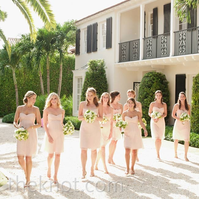 Lindsay knew that simple dresses would flatter all nine of her bridesmaids, so she chose two pale-pink chiffon styles: one with straps and one without.