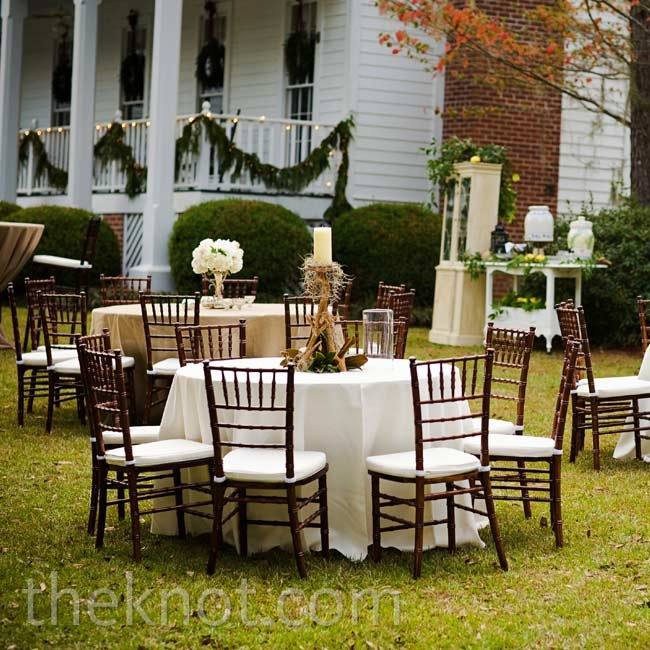 To create an effortless look, each of the tables had slightly unique decor, such as burlap or ivory tablecloths, antler candlestick centerpieces or white floral arrangements.