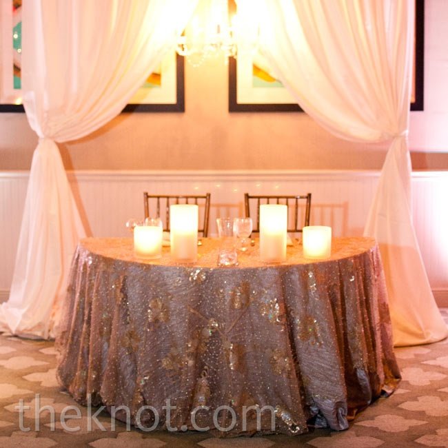 The sweetheart table was adorned in a pearl-, crystal- and sequin-encrusted tablecloth.