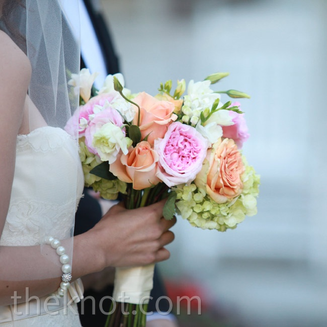 Flowers in sherbert colors like pink, peach, and lime made up Mary's bouquet.
