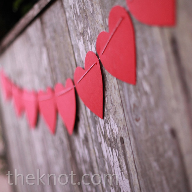 A simple red paper heart garland decorated the outdoor space.