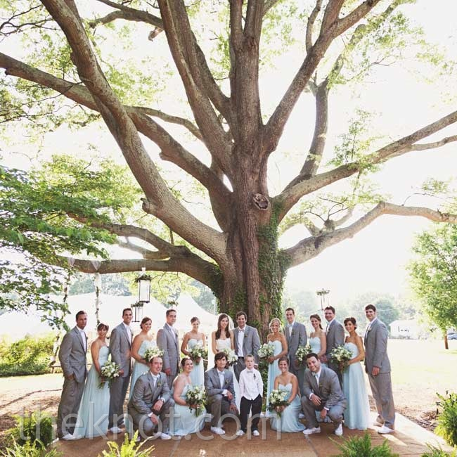 The bridesmaids wore light-aqua chiffon gowns, while the guys looked casual in gray suits and white Converse sneakers.
