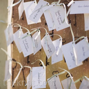 Antique skeleton keys added a vintage vibe to the escort cards, which were tied with ribbon and pinned to an old screen door.