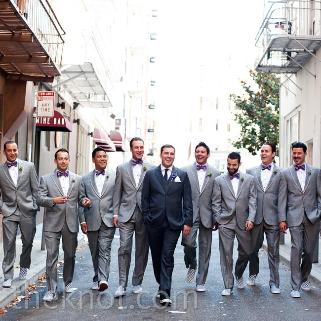 Light-gray tuxes, purple bow ties and sneakers fit the fun-loving group.