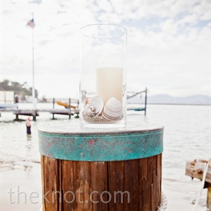 Large cylinder vases filled with seashells decorated the waterside ceremony.