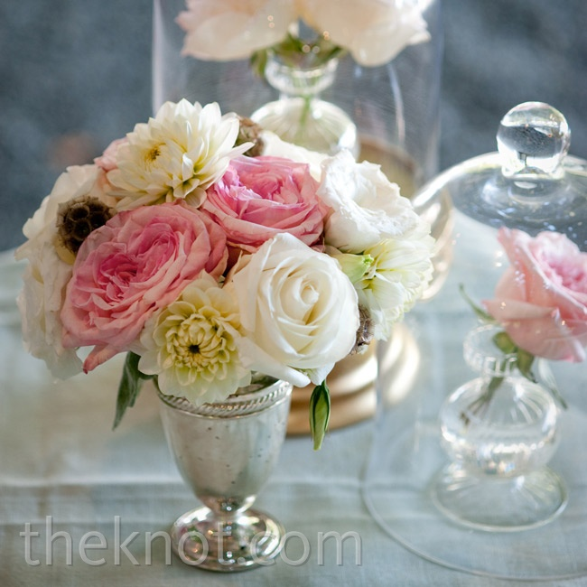 Varied containers gave the centerpieces an eclectic, vintage vibe.