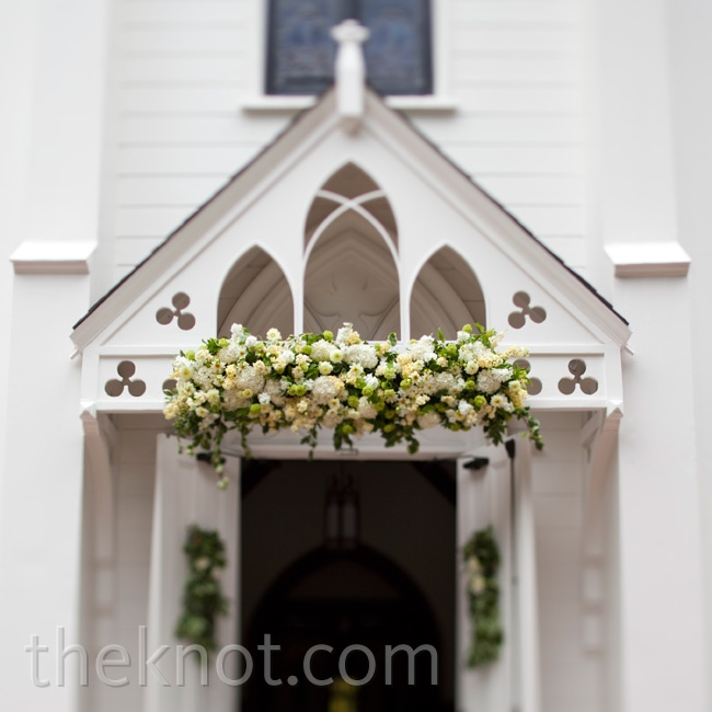 A lush entrance arrangement adorned the doors to the same church where Melissa's parents were married 33 years earlier.