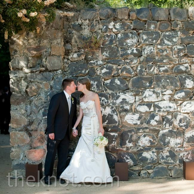 Shannon's sleek bustier silhouette complemented the wedding's overall upscale-rustic look.