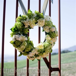 Lush hydrangea wreaths welcomed guests to the ceremony location.