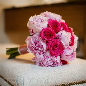 Vibrant pink roses mixed with softer pink peonies brought color to Alice's look.