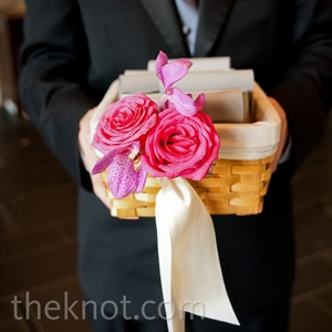Ushers passed out programs to guests from floral-adorned baskets.
